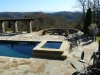 Geometric pool with raised spa, arbor and outdoor firepit