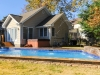 Freeform pool with raised inground spa and deck pavers