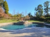 Freeform pool with raised inground spa and deck pavers
